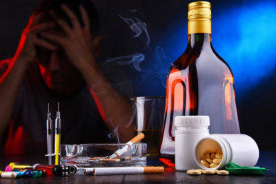 Addictive substances and the figure of a addicted man.