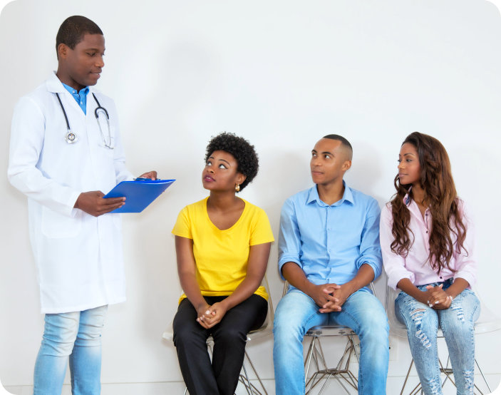 people listening to a doctor