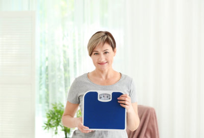 woman holding weighing scale